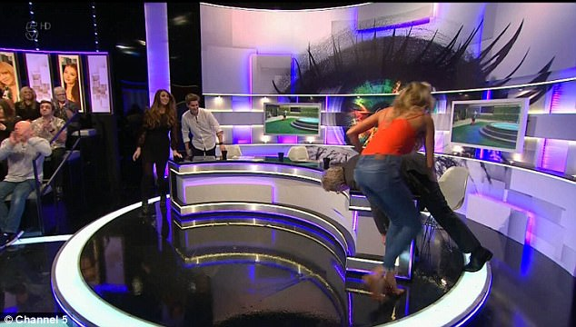 Hands on: The blonde, 26, threw herself into an exercise sketch on the show - but caught more attention when she interrupted the workout to give Jim Davidson, 64, a slap on the bottom
