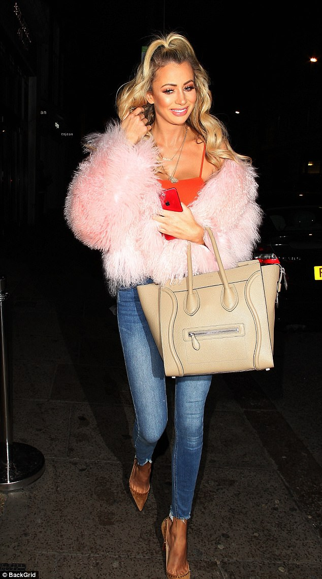 Covering up: The reality starlet kept the chill at bay with a candyfloss pink faux fur jacket