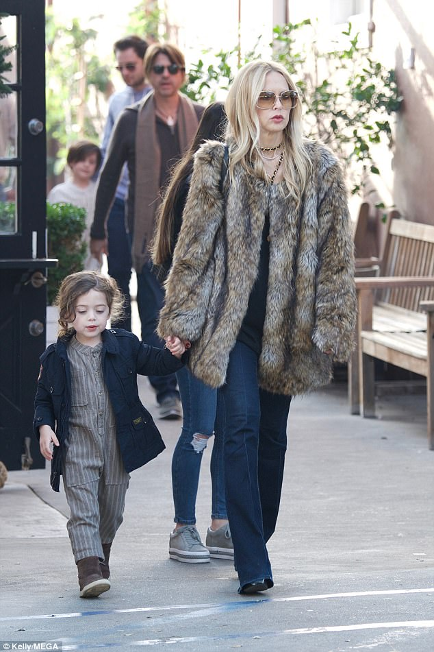 Chic:Rachel Zoe didn't let her standards slip over the holidays as she cut an effortlessly chic figure whilst out shopping with her son Kaius in Los Angeles on Tuesday