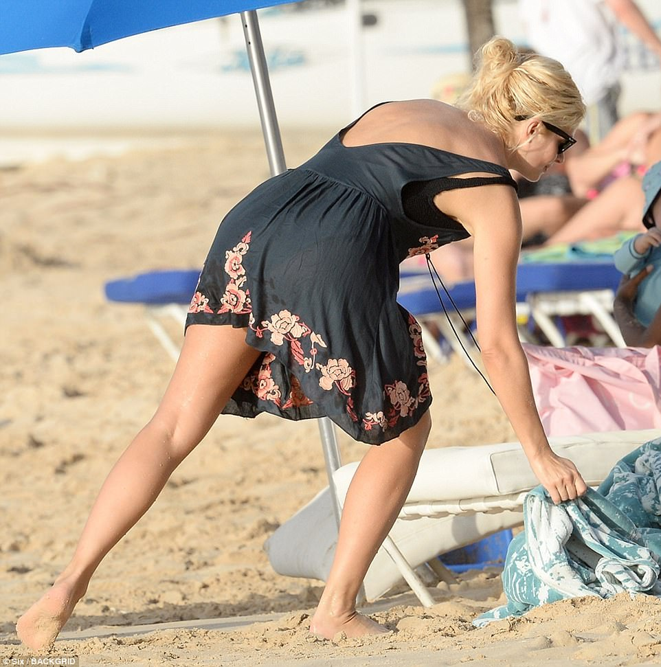 Towelling off: The Dancing On Ice presenter returned to her sunlounger to retrieve a towel during the action-packed day out
