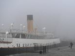 The former White Star Line tender, theSS Nomadic, is shrouded in fog at the Titanic Quarter in Belfast this afternoon