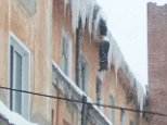 Yevgeny Tikhonov was found dangling from the roof of a student dormitory in the Siberian city of Kemerovo