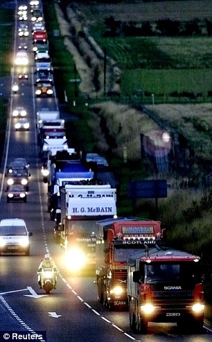 Confrontation: Thousands of truckers are preparing to go head to head with the army in support of striking tanker drivers - and have warned they will 'bring Britain to a halt'. A convoy of trucks are pictured during the blockades in 2000