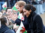CARDIFF, WALES - JANUARY 18:  Prince Harry and his fiancee Meghan Markle shake hands with children as they arrive to a walkabout at Cardiff Castle on January 18, 2018 in Cardiff, Wales.  (Photo by Chris Jackson/Chris Jackson/Getty Images)