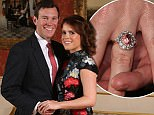 Princess Eugenie and Jack Brooksbank in the Picture Gallery at Buckingham Palace in London after they announced their engagement. Princess Eugenie wears a dress by Erdem, shoes by Jimmy Choo and a ring containing a padparadscha sapphire surrounded by diamonds.  PRESS ASSOCIATION Photo. Picture date: Monday January 22, 2018.  They are to marry at St GeorgeÌs Chapel in Windsor Castle in the autumn this year. See PA story ROYAL Eugenie. Photo credit should read: Jonathan Brady/PA Wire