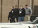 Police were seen leading a teen, believed to be the 15-year-old shooter, away in handcuffs after he opened fire on classmatesat Marshall County High School in Kentucky on Tuesday morning