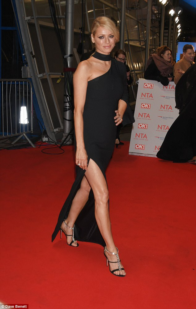 Raunchy: The NTA veteran was solo for her red carpet excursion - with husband Vernon Kay nowhere in sight - but wowed the crowd nonetheless in her usual sartorial excellence