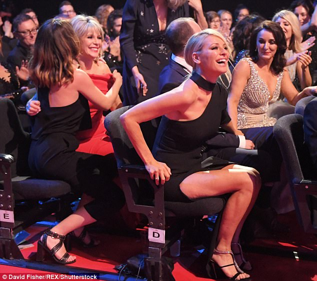 Jubilant: Tess leapt out of her seat during the ceremony once Strictly was announced a winner