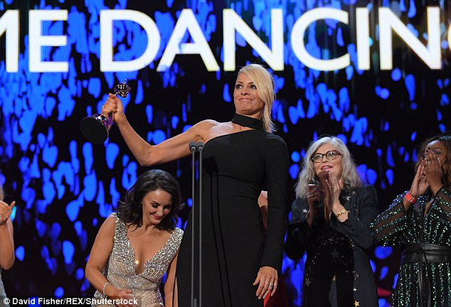 Hear the applause: Flanked by Strictly judge Shirley Ballas and recent ballroom contestants, Tess raised her award as she paid tribute to her late co-host