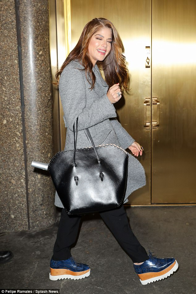 Bags of style: Selma looked more than happy to smile to the cameras as she sauntered down the street