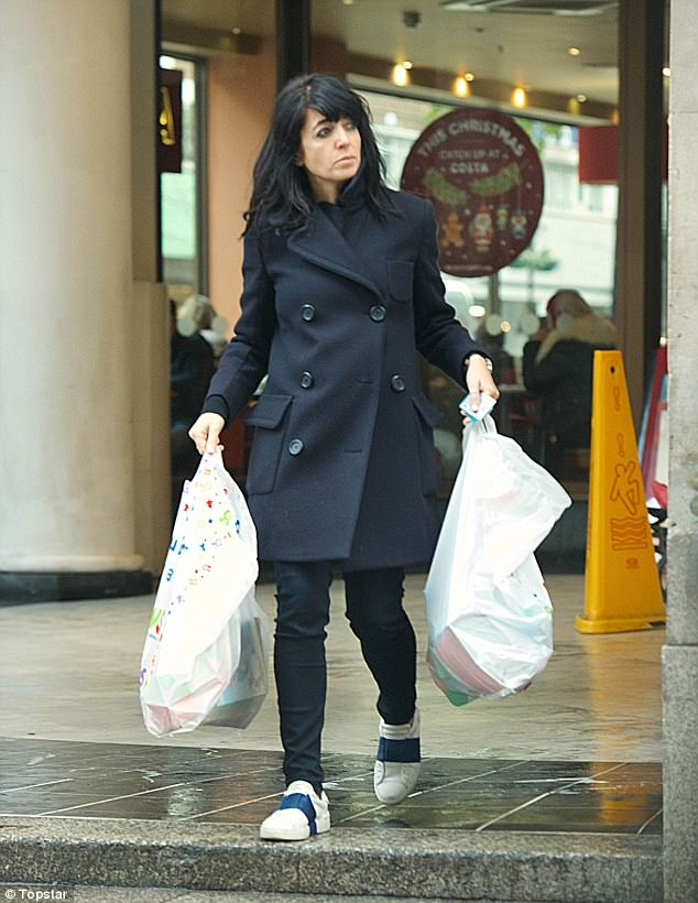 Generous mum:Claudia Winkleman seemed keen to treat her three children to some presents over the festive period as she splashed out on a shopping trip at Toys R'Us in London on Wednesday