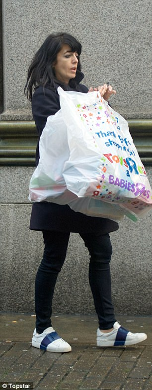 Good trip?Winkleman, who lives in London, went solo for the casual shopping trip and seemed to have had a successful outing as she carried several heavy bags