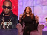 Wendy Williams began discussing the #MeToo movement in relation to a grassroots push to get singer R. Kelly out of the music industry altogether (Wendy in front of a photo of R. Kelly)