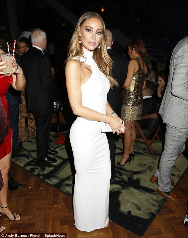 All white on the night: Lauren Pope took time out to pose for a snap amid the raucous revelry