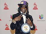 FILE - This Nov. 20, 2014 file photo shows rapper Flavor Flav, whose real name is William Jonathan Drayton Jr., at the 15th annual Latin Grammy Awards in Las Vegas. Police in Las Vegas say Ugandi Howard, 44, is facing a misdemeanor battery charge for attacking the entertainer at a local casino. Officer Laura Meltzer said, Thursday, Jan. 25, 2018, that Drayton was taken to a hospital for treatment of minor injuries after the incident on Tuesday. Howard was issued a summons to appear March 6 in Las Vegas Justice Court. (Photo by Al Powers/Invision/AP, File)