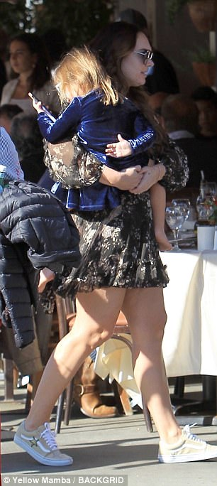 Doting mother: Tamara was seen cradling daughter Sophia, three, in her arms