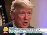 President Donald Trump is pictured during his first international TV interview, with Piers Morgan, in which he said he would come to the UK for a state visit later this year