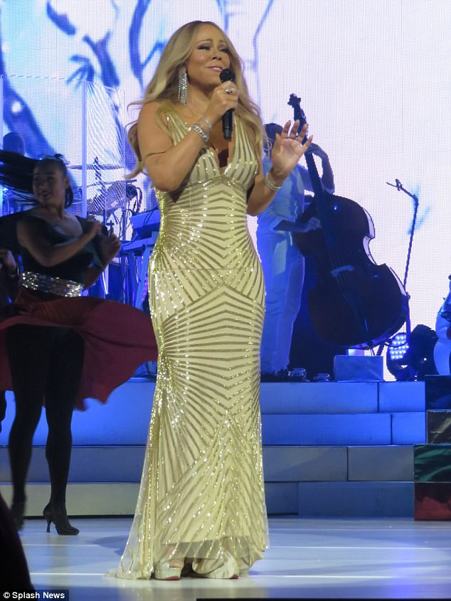 Golden girl: Carey was the first live headline performer in Times Square for the longtime special in 2005, and that performance went seamlessly; seen on Wednesday