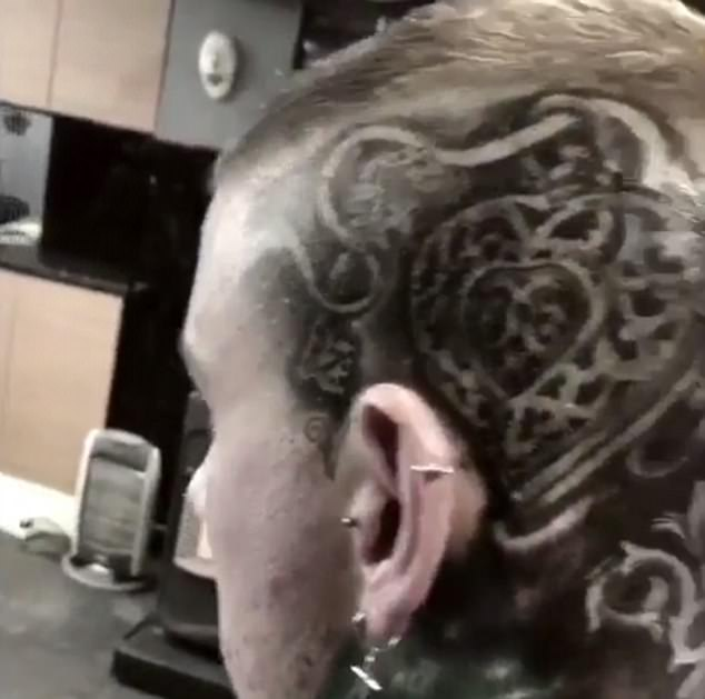 Pierced: He also displayed his piercings on his ears with his head cleanly shaved