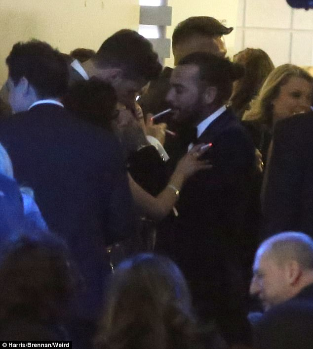 Up close and personal: While the duo were seen to be getting close in the smoking area, there was undoubtedly a risk of awkwardness as both their exes - with whom they have had high profile splits - were also living it up at the event