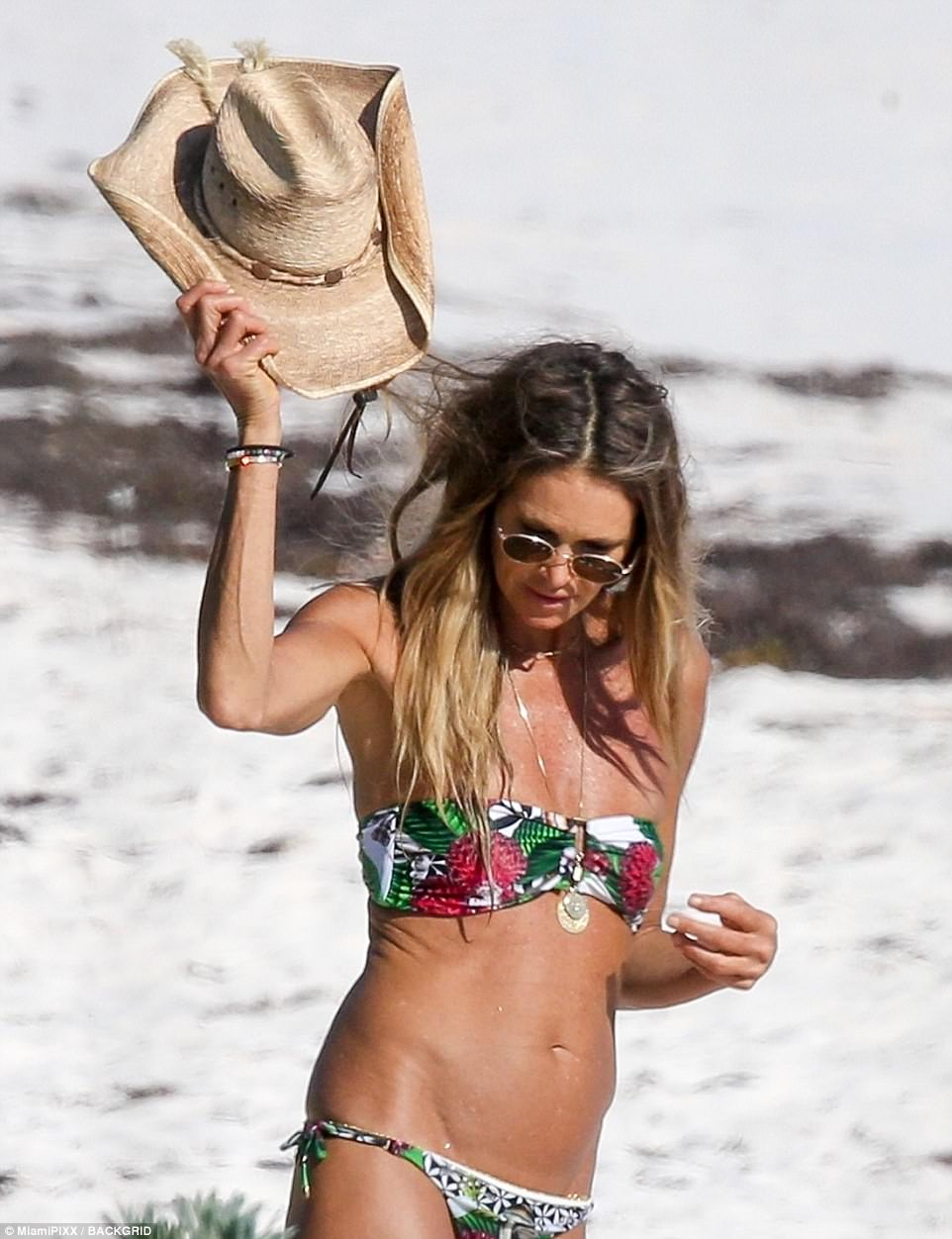 Hats off to her! Elle revealed she looks after herself by getting at least seven hours' sleep a night, drinking at least three liters of water a day and sticking to a healthy, nourishing diet