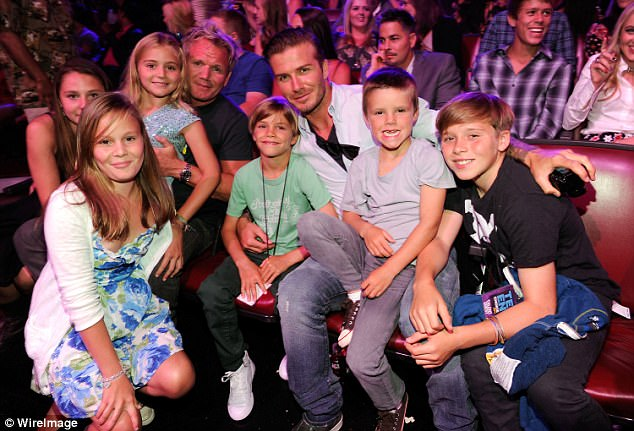 Family time:The Beckhams and the Ramsay families have indulgent dinner parties, share lavish holidays and they have even celebrate Christmas together (pictured Gordon, David, Romeo, Cruz, Brooklyn, Megan, Holly and Tilly at the 2011 Teen Choice Awards in California)