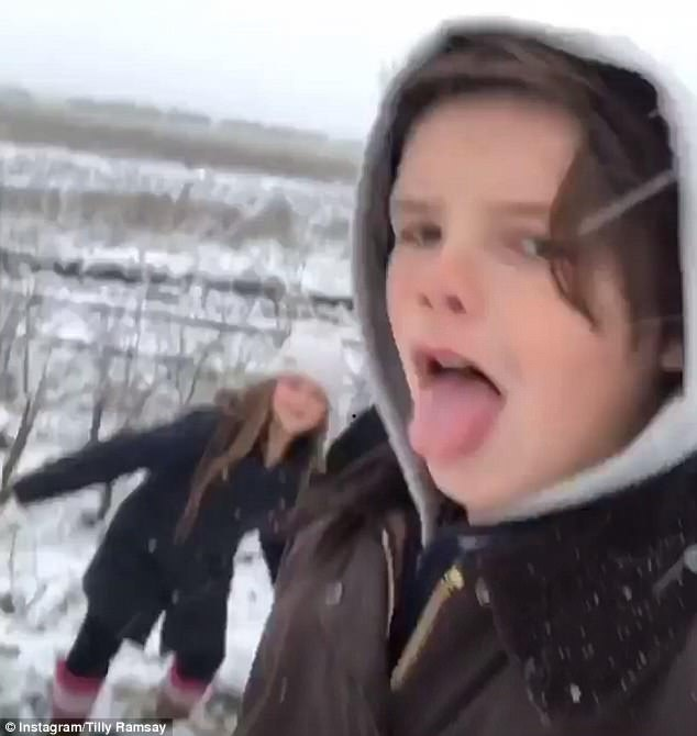 Cruz-ing through the snow! Cheeky Beckham son played with Tilly Ramsay on their icy outdoor adventure as they escaped the rest of the clan on countryside getaway on Monday
