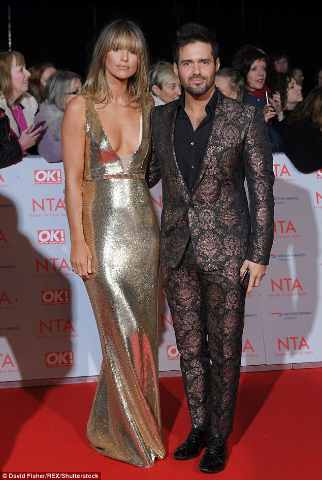 Gorgeous couple: Glamorous Vogue Williams flaunts her eye-popping cleavage in a shimmering gold gown while boyfriend Spencer Matthews cuts a flamboyant look at the NTA red carpet