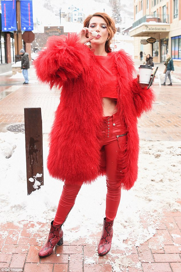 The lady in red: Bella stood out in an elaborate ensemble in a shot taken earlier Monday
