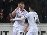Sam Clucas of Swansea City was captured making the gesture in Tuesday's game against Arsenal