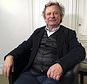 """Frederic Durand-Baissas, a 59-year-old Parisian teacher and art lover, poses during an interview in Paris, Thursday, Feb. 1, 2018.  Durand-Baissas, whose Facebook account was suspended in 2011 after he posted a photo of Gustave Courbet's 1866 painting """"The Origin of the World,"""" which depicts female genitalia, is suing the California-based social network Facebook for alleged """"censorship"""". (AP Photo/Laurent Rebours)"""