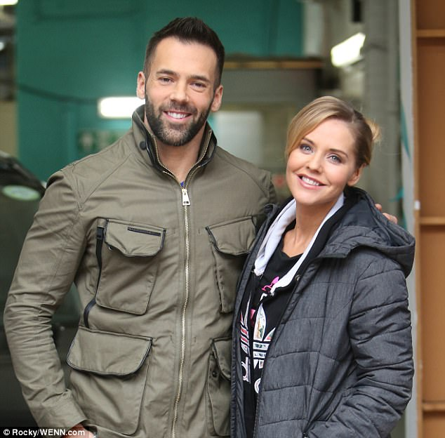 Beaming brightly: The professional dancer wrapped his arm around his celebrity partner as they posed for a picture outside the ITV studios