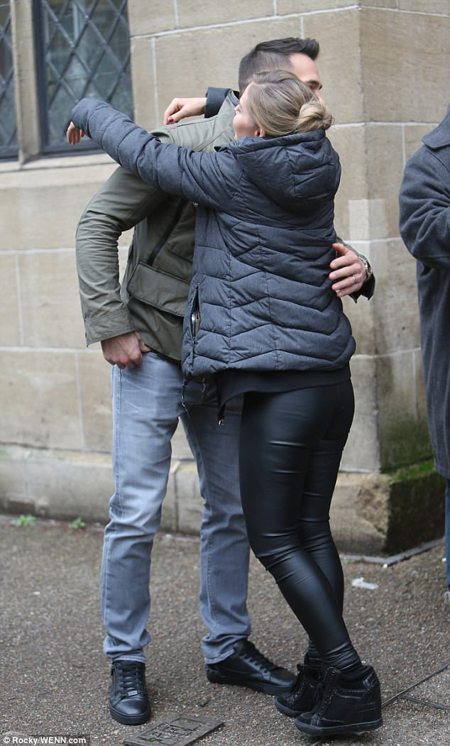 Stylishly in sync: Sylvain donned a olive green puffer jacket while Stephanie opted for one in navy to keep the chill off to the British streets