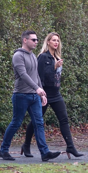 The apparent mother-to-be was dressed in a tight-fitting band t-shirt which appeared to showcase her bump