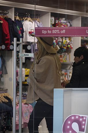 She could be seen perusing the 50 per cent off sale