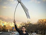 Women in Iran protesting against wearing the obligatory Islamic headscarf have continued to take theirs off and wave them on sticks