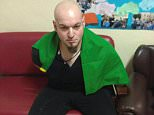 The suspected gunman, who has been named locally as Luca Traini, 28, has a Nazi tattoo on his head