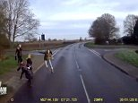 The three children step out on the road into the path of an oncoming lorry, forcing the driver to slam on the brakes