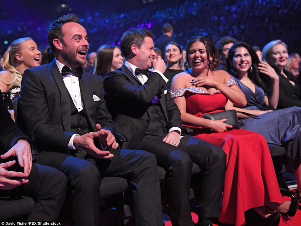 Laughing away: Before accepting their award, the group seemed in excellent spirits as they settled down to watch the show