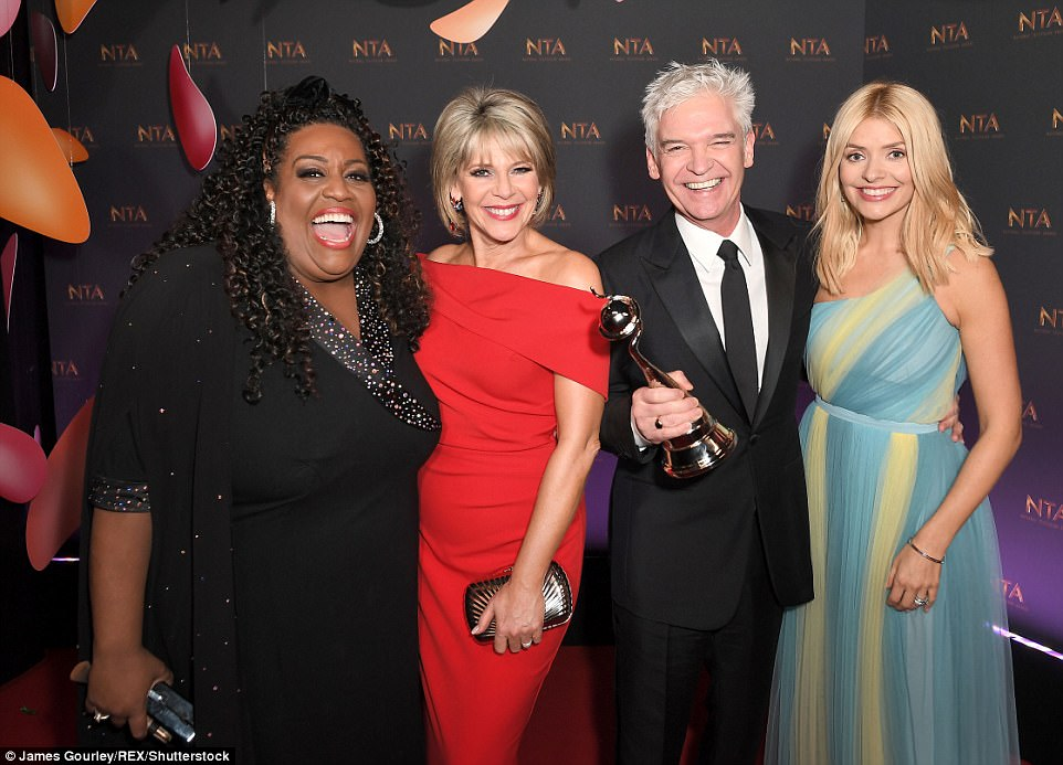 Fantastic four: The This Morning stars Alison Hammond, Ruth Langsford, Phillip Schofield and Holly Willoughby posed with their award as they headed backstage after their big win
