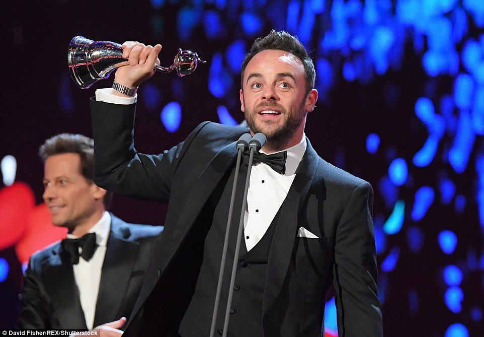 Winner: Ant brushed his divorce woes aside as he triumphantly brandished his award in the air while on stage