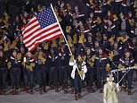 Erin Hamlin carries the flag of the United States during the opening ceremony of the 2018 Winter Olympics in Pyeongchang