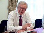 David Davis (pictured in 9 Downing Street yesterday) slammed Brussels for threatening to punish Britain during the Brexit transition period today