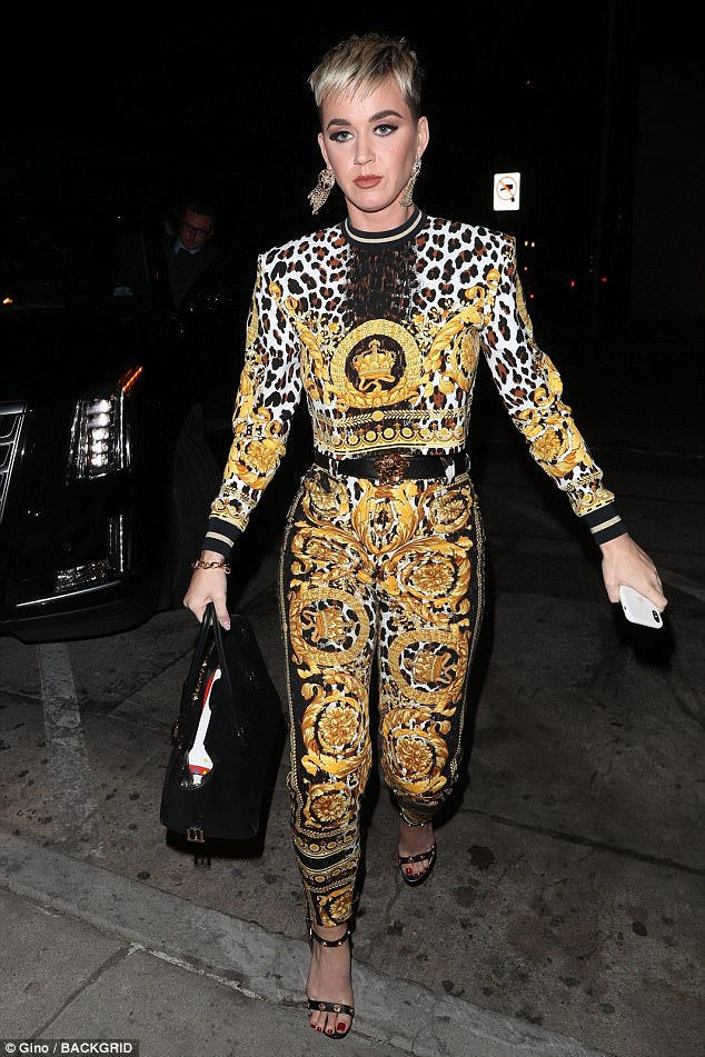 Out on the town: Katy Perry headed to dinner at trendy Craig's in West Hollywood on Tuesday night wearing a leopard print two-piece embellished with gold thread motifs