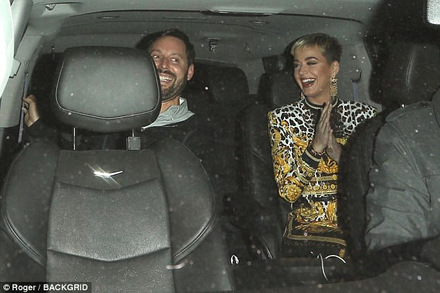 Giggling away: As she headed into the cab she was having a wonderful time
