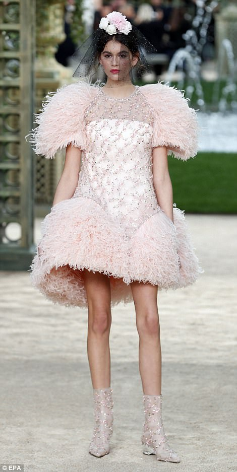 Glitz and glamour: Her delicate boots were covered in pink crystals which added some further sparkle