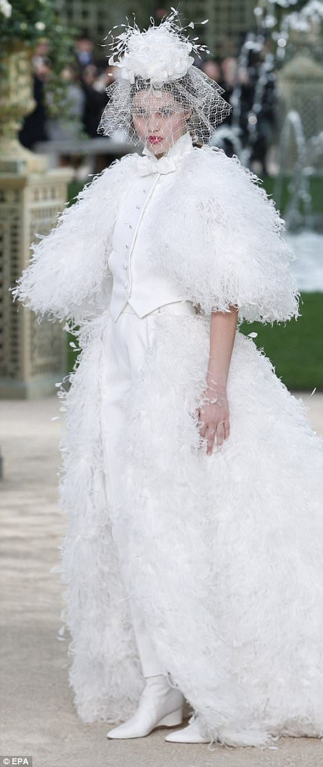 Here comes the bride: This stunning white ensemble is the perfect look for spring/summer weddings