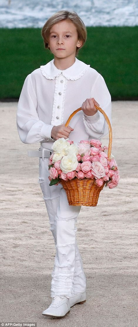 Family member: Karl Lagerfeld's godson Hudson Kroenig looked cute in his all-white get-up