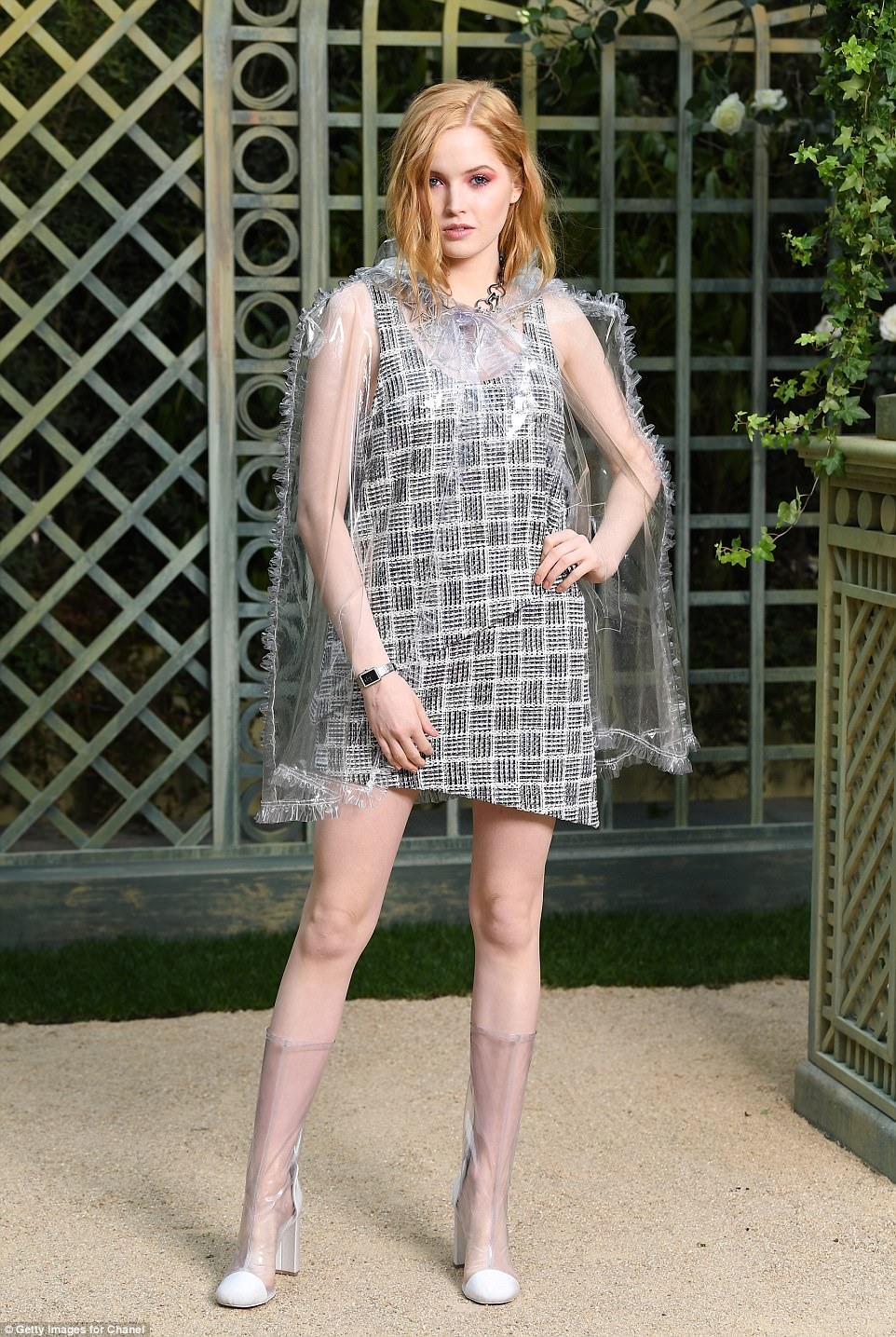 Wow factor: Ellie Bamber showed off her fashion credentials in a perspex dress and boots