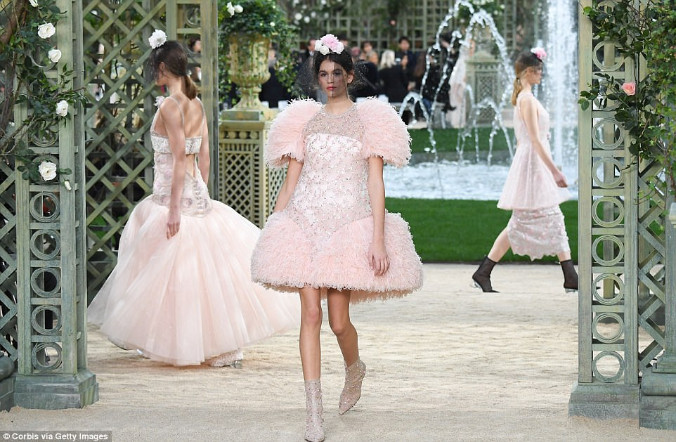 Summer garden: Kaia was surrounded by a series of model wearing different versions of her look which appeared to be bridal in style - no doubt there will be a waiting list for this beauties